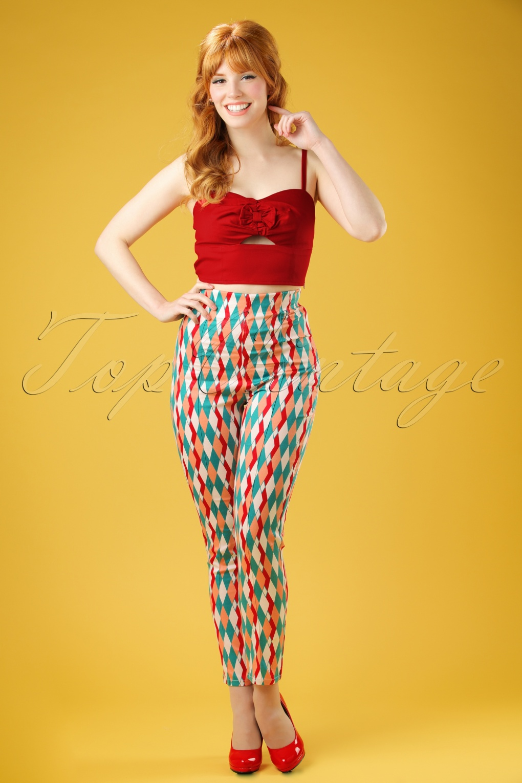 1960s Inspired Fashion: Recreate the Look 50s Bonnie Atomic Harlequin Trousers in Red and Jade £33.76 AT vintagedancer.com