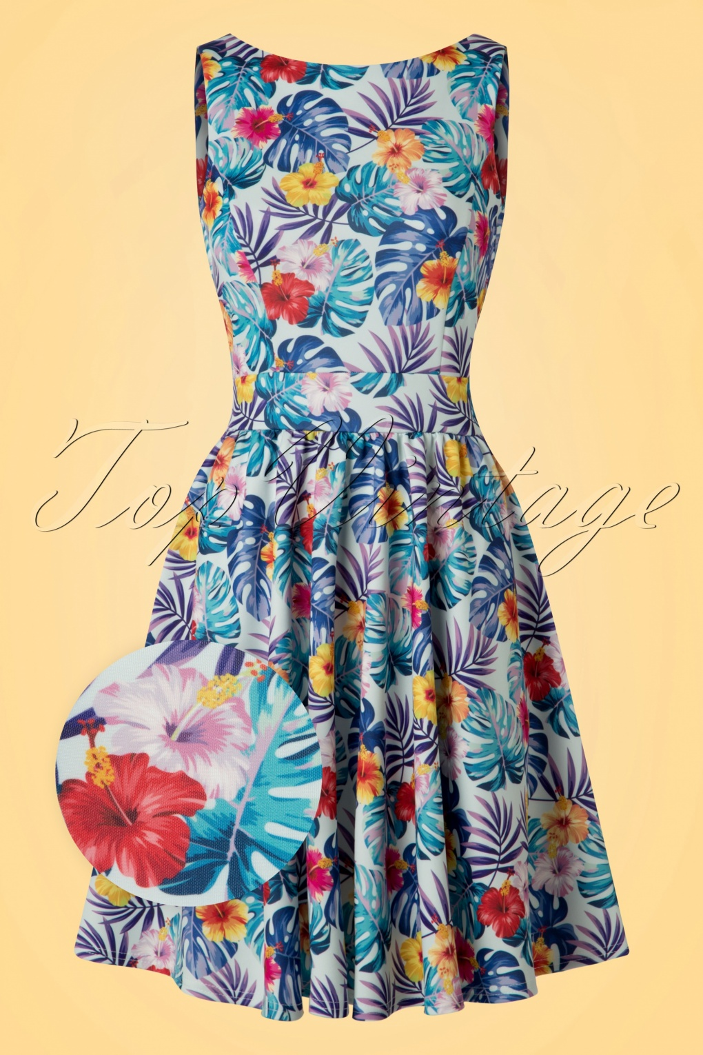 1960s Dresses – A Rainbow of 50 Dresses (Pictures) TopVintage exclusive  50s Tea Tropical Leaves Swing Dress in Light Blue £69.92 AT vintagedancer.com
