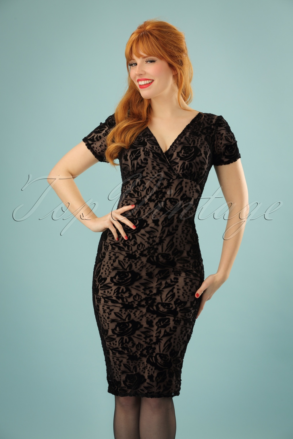 The Lace Trim Pencil Dress With Crossover Hem is made of a sexy fabric with a bit of stretch to it. It has a rounded neckline and a fitted pencil cut. The best part of this dress has to be the semi-sheer lace that trims the neckline and bottom hem of the skirt.