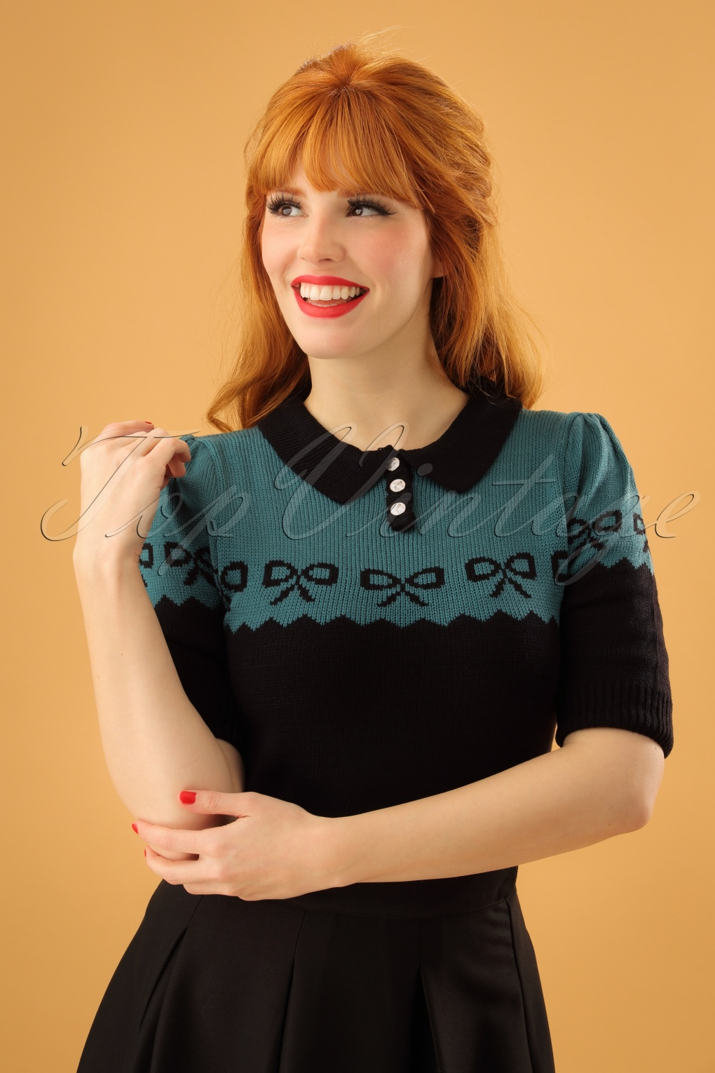 Vintage Sweaters: Cable Knit, Fair Isle Cardigans & Sweaters 40s Berit Bow Jumper in Black and Blue £28.08 AT vintagedancer.com