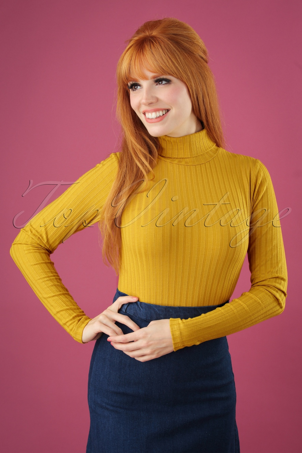 Vintage Sweaters: Cable Knit, Fair Isle Cardigans & Sweaters 70s Rollneck Roulette Top in Sunset Yellow £43.75 AT vintagedancer.com