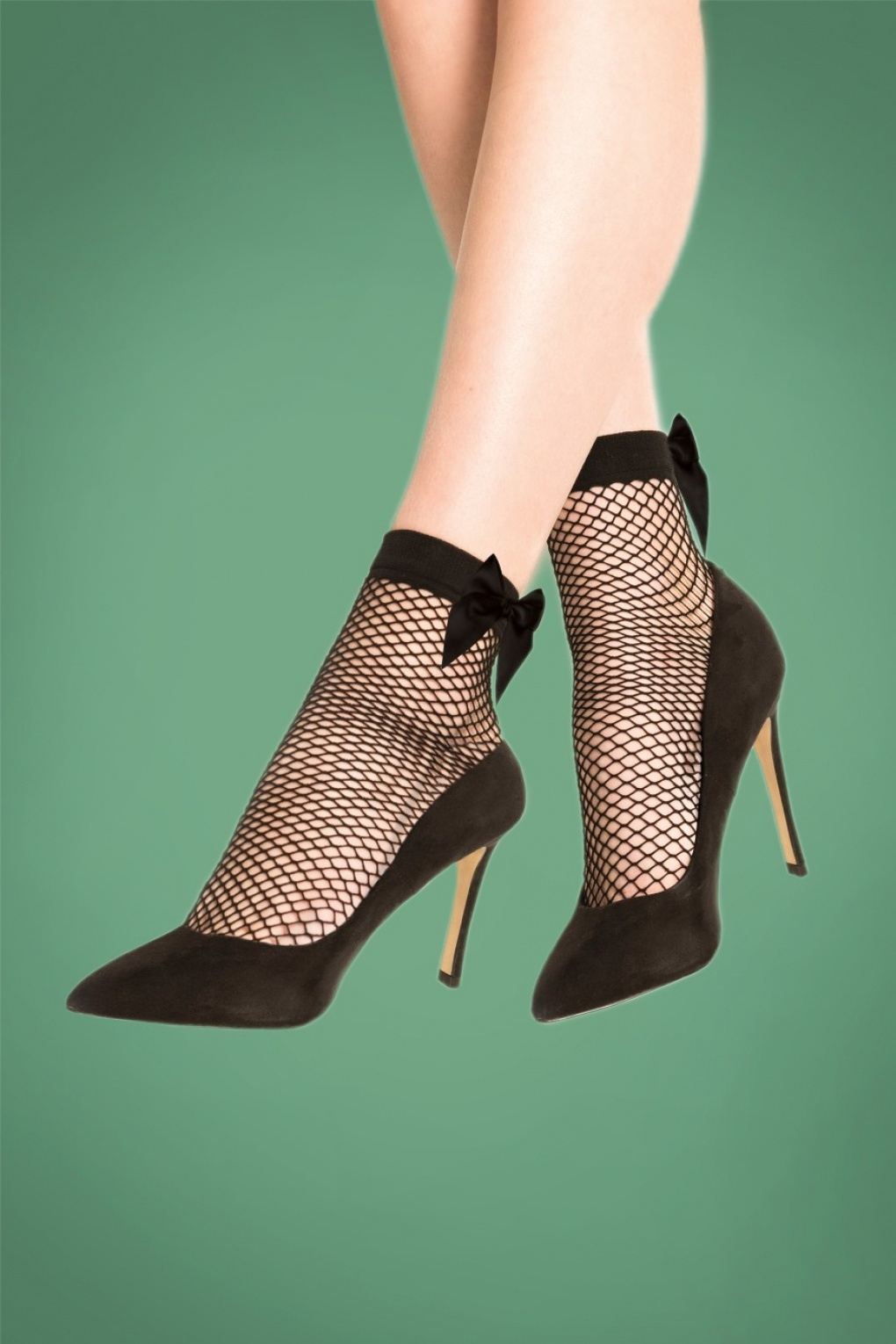 1950s Stockings and Nylons History & Shopping Guide 50s Bow Fishnet Socks in Black £7.08 AT vintagedancer.com
