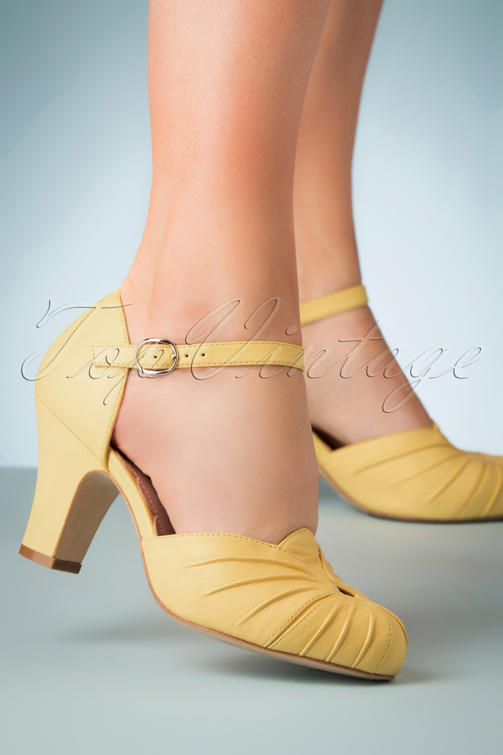 1950s Shoe Styles: Heels, Flats, Sandals, Saddles Shoes 40s Amber Mary Jane Pumps in Pastel Yellow �151.28 AT vintagedancer.com