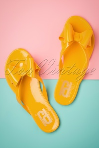 60s Lucky Bow Flip Flops in Super Yellow