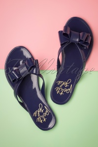 60s Lucky Bow Flip Flops in Pearl Navy