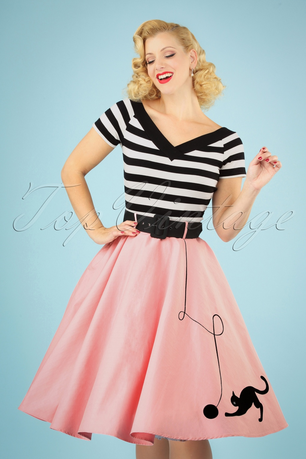 How to Dress for a 50s Sock Hop 50s Kitty Cat Swing Skirt in Light Pink �51.99 AT vintagedancer.com