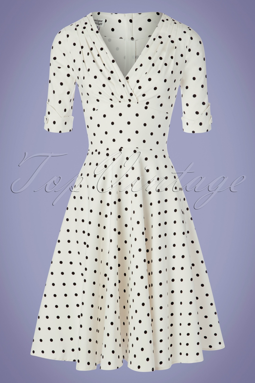 Polka Dot Dresses: 20s, 30s, 40s, 50s, 60s 50s Delores Dot Swing Dress in White and Black £73.25 AT vintagedancer.com