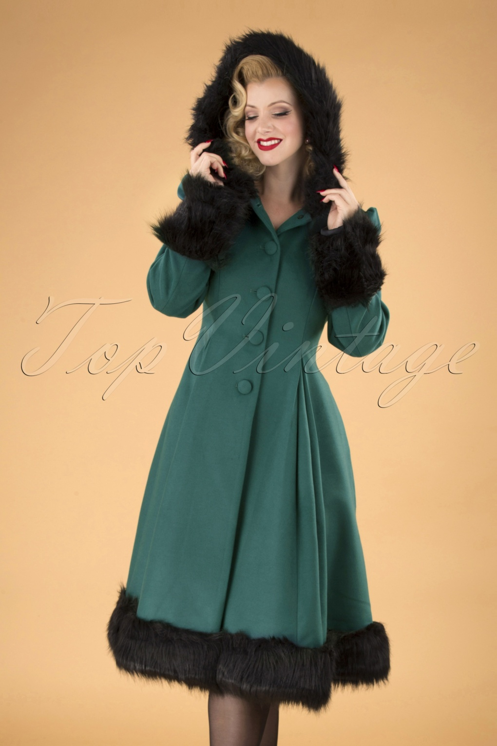 History of 1920s Coats, Furs and Capes 30s Elvira Coat in Deep Green £118.19 AT vintagedancer.com