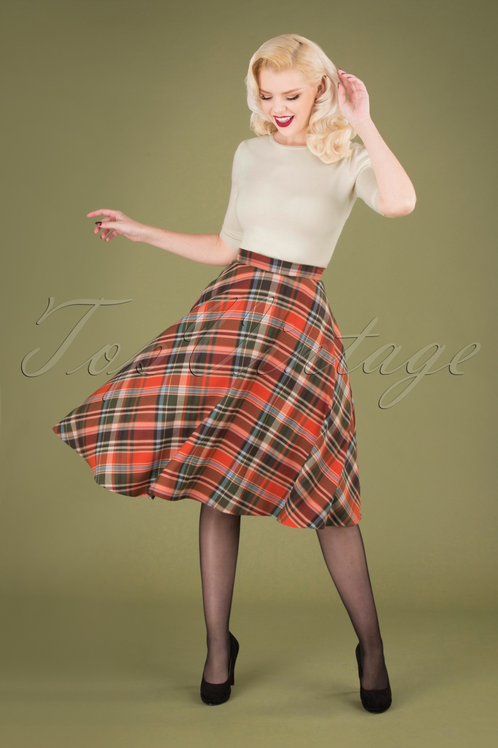 1940s Teenage Fashion: Girls 50s Oktober Tartan Swing Skirt in Orange £45.04 AT vintagedancer.com