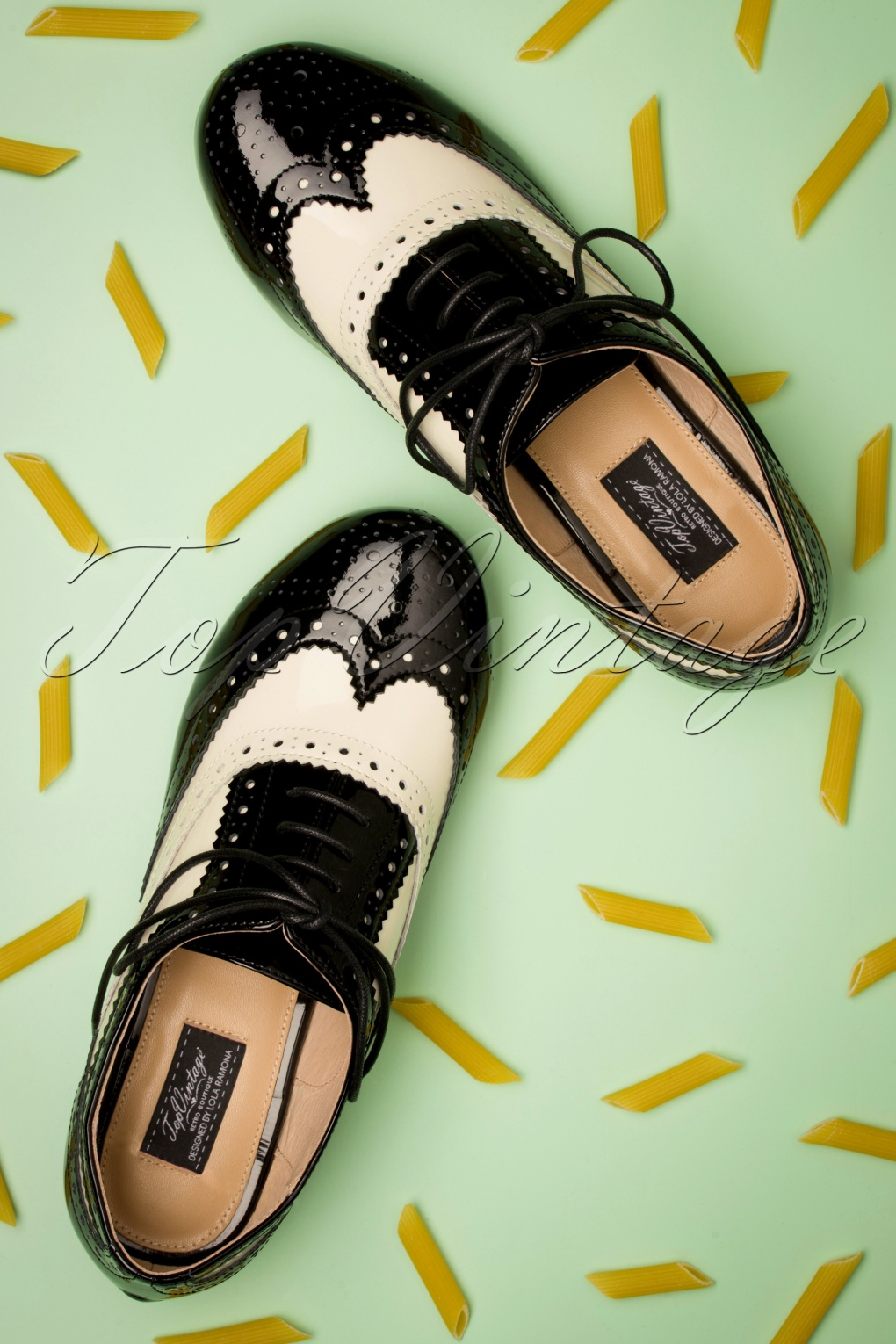 Saddle Shoes History 60s Penny Goes To Italy Brogue Flats in Black and Off White £108.11 AT vintagedancer.com