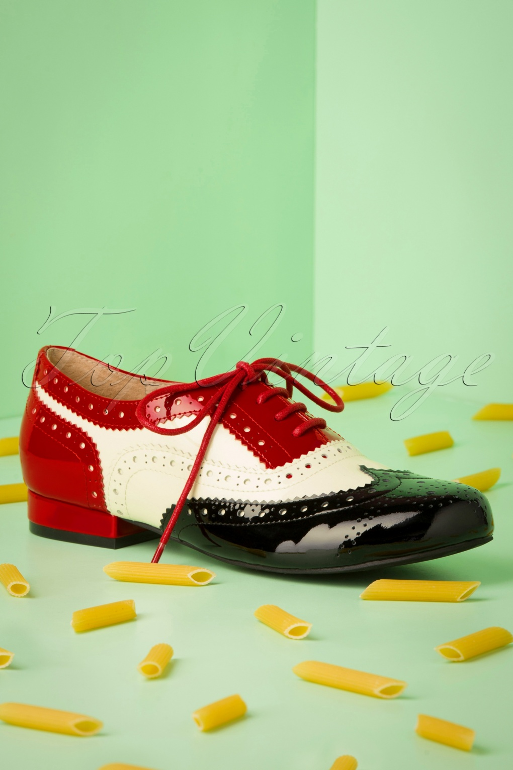 Saddle Shoes History 60s Penny Goes To Italy Brogue Flats in Black and Red £108.11 AT vintagedancer.com