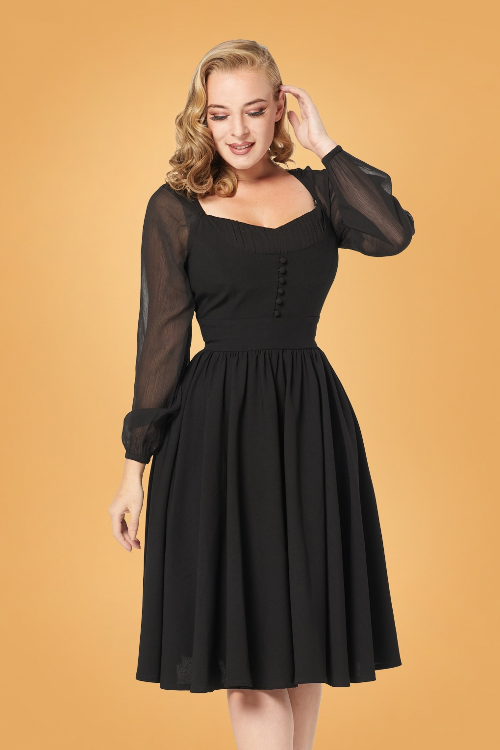 What Did Women Wear in the 1950s? 1950s Fashion Guide 50s Dion Swing Dress in Black £71.07 AT vintagedancer.com