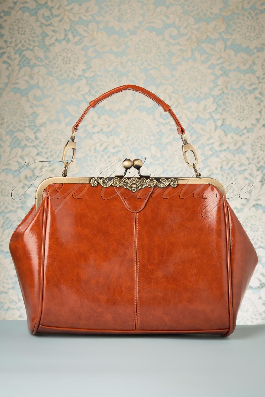 1920s Accessories: Feather Boas, Cigarette Holders, Flasks 20s Vintage Frame Kisslock Clasp Bag in Tan £33.99 AT vintagedancer.com