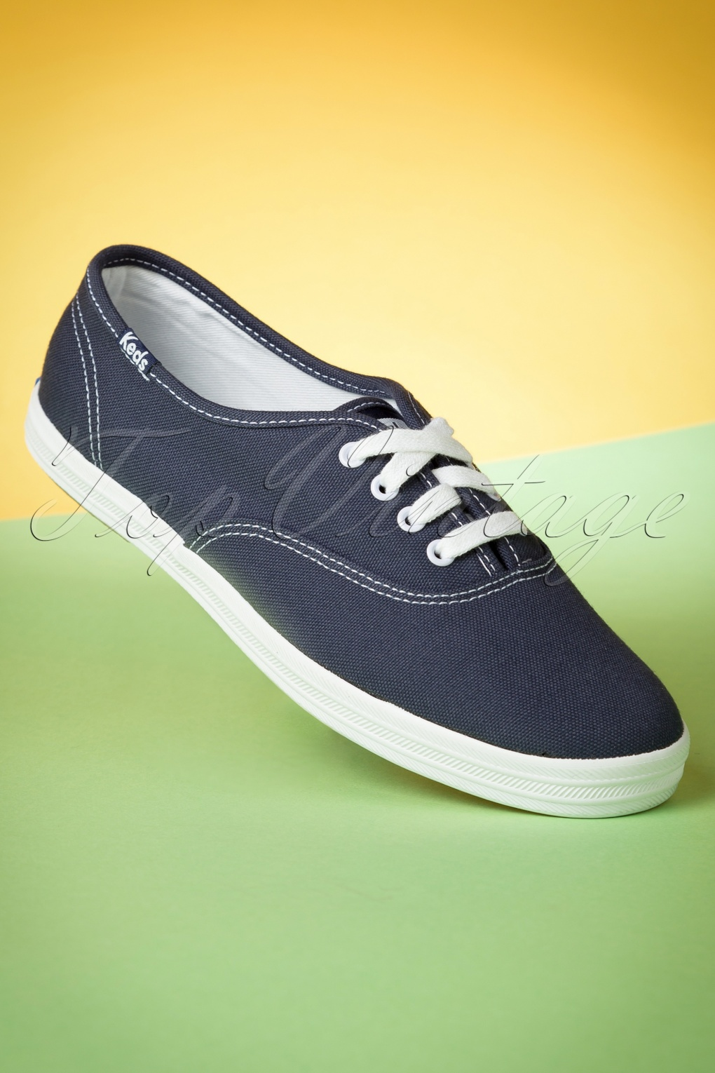 Retro Vintage Flats and Low Heel Shoes 50s Champion Core Text Sneakers in Navy £52.49 AT vintagedancer.com